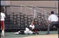Rival women's softball player slides in front of Augsburg women's softball player, May 1992