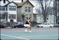 Augsburg women's tennis player prepares to hit incoming ball with racket, 1991