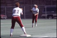 Augsburg women's softball player throws ball to teammate, May 1992