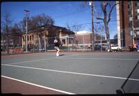 Augsburg women's tennis player prepares to hit incoming ball, April 1993