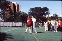 Augsburg women's soccer player talks with woman, 1991
