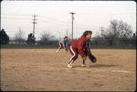 Augsburg women's softball player bending knees, April 1992