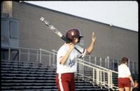 Augsburg women's softball player holding up hand, April 1992