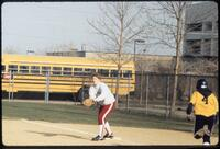 Augsburg women's softball player catches ball, April 1992