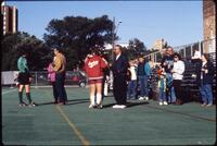 Augsburg women's soccer player talks with family, 1991