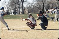 Augsburg women's softball catcher with arm extended out, April 1992