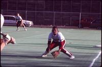 Augsburg women's softball player prepares to catch ball, 1991