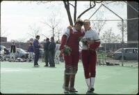 Augsburg women's softball catcher and player take photo together, 1991