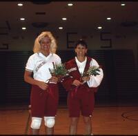 Augsburg women's volleyball player takes photo with coach, November 1992