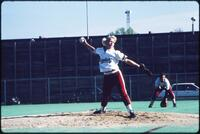 Augsburg women's softball pitcher mid-pitch, 1991