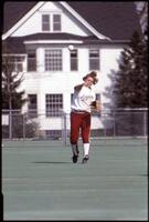 Augsburg women's softball player throws the ball, May 1992