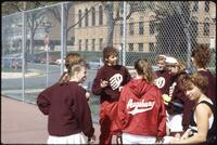 Augsburg women's tennis players talk with their coach, 1991