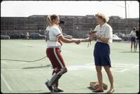 Augsburg women's softball player receives rose from coach, April 1992
