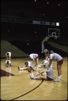 Augsburg women's basketball players stretching, February 1992