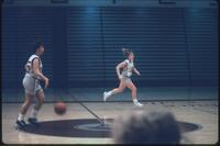 Augsburg women's basketball player runs down court, February 1992