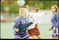 Augsburg women's soccer player and rival players during a game, 1991