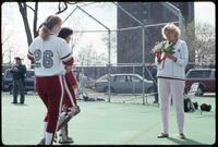 Augsburg women's softball coach handing out roses, 1991