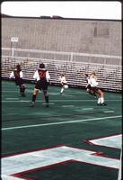 Augsburg women's soccer player kicks ball, 1991