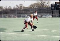 Augsburg women's softball player during game, April 1992