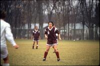 Augsburg women's soccer player standing on field, 1991