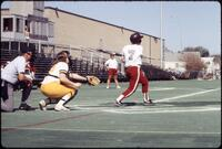 Augsburg women's softball player swings bat, May 1992