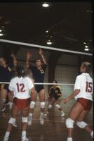 Augsburg women's volleyball players by the net, 1991