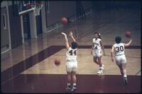Augsburg women's basketball player jumps to shoot, February 1993