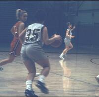 Augsburg women's basketball player dribbling, 1991