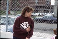 Augsburg women's tennis coach with notebook under her arm, 1991