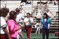 Augsburg women's softball player holding red rose, 1991