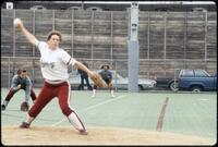 Augsburg women's softball pitcher pitches ball, April 1992
