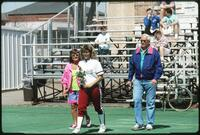 Augsburg women's softball player holding rose, 1991
