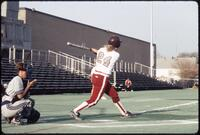 Augsburg women's softball player swings bat, April 1992