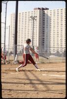 Augsburg women's softball player swinging bat, 1991