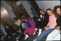 Augsburg women's basketball player sit on the floor beside each other, December 1991