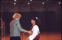Augsburg women's volleyball player talks with coach, November 1992