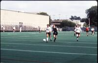 Augsburg women's soccer player kicks ball down the field, 1991