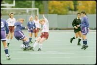 Augsburg women's soccer player tries to get ball away from rival player, 1991