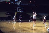 Augsburg women's basketball player practices shooting hoops, February 1992