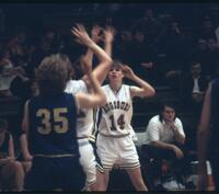 Augsburg women's basketball player holding her arms up, March 1993