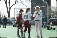 Augsburg women's softball player receives rose from coach, 1991
