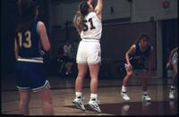 An Augsburg women's basketball team player shoots a foul shot, 1993.