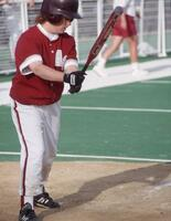 Augsburg women's softball team batter in action, 1995.