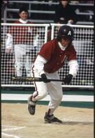 An Augsburg women's softball team batter hits a ball, 1997.