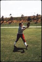 An Augsburg women's softball team player warms up, 1997.