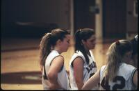 Augsburg women's basketball team players during a timeout, 1993.