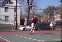 An Augsburg women's tennis player plays in a match, circa 1990.