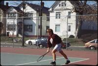 An Augsburg women's tennis player plays in a match, circa 1985.