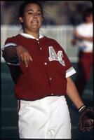 An Augsburg women's softball team player throws the ball, 1997.