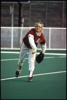 An Augsburg women's softball outfield team player throws the ball, 1997.